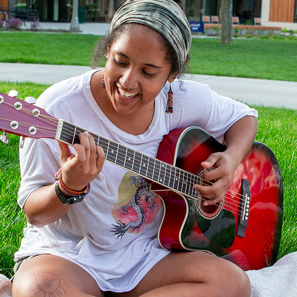 A student plays guitar