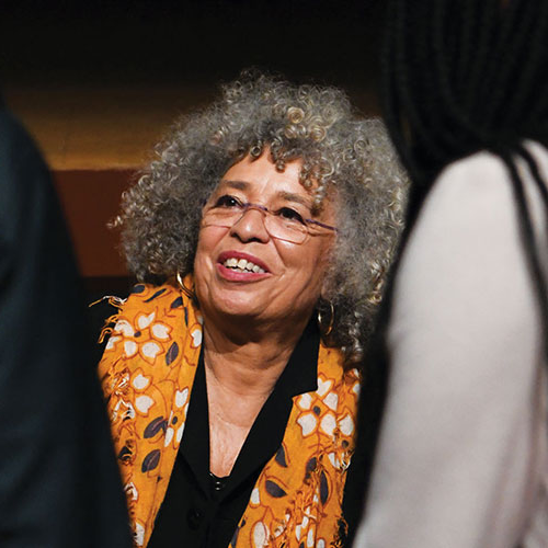 Angela Davis talking with a group