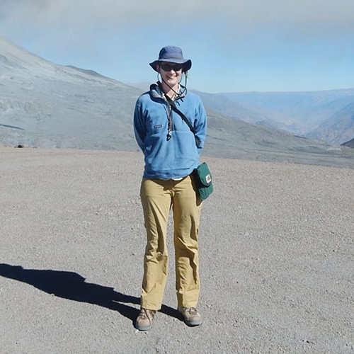 Heather Wright '99 stands in front of Ubinos, a volcano in Peru, during a period of explosive eruptions in 2015.